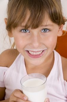 Free Smiling Girl With Glass Of Milk Looking Royalty Free Stock Image - 6753906