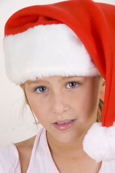 Free Smiling Little Girl Wearing Christmas Hat Royalty Free Stock Image - 6753916