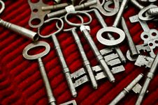 Old Keys On A Red Cloths Stock Photo