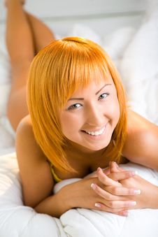 Red-haired Beauty In Bed Royalty Free Stock Images
