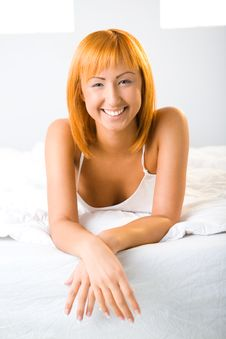 Young Woman Resting In Bed Stock Photo