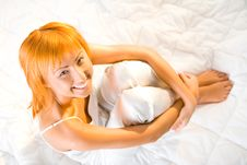 Young Woman Sitting On Bed Stock Images
