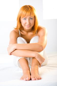 Free Sexy Redhead Sitting On Bed Royalty Free Stock Photos - 6756628