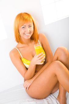 Beauty With Orange Juice Royalty Free Stock Photography