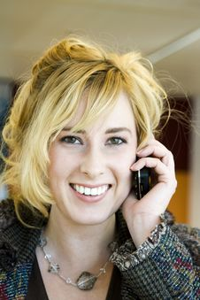 Free Young Blonde Caucasian Woman Answering Phone Royalty Free Stock Images - 6756859
