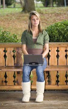 Teenage Girl Using Her Laptop In The Park Royalty Free Stock Photos