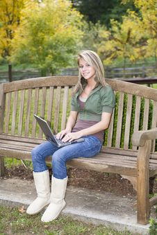 Teenage Girl Using Her Laptop In The Park Stock Images