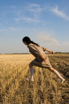 Free Girl Running On The Field Stock Photos - 6759603