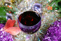 Free Single Glass Of Red Wine On A Christmas Background Stock Photo - 6763560