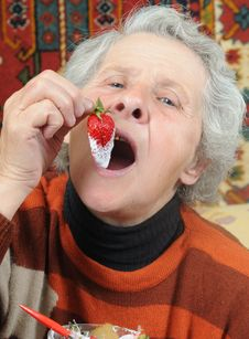 Free Grandmother Eats Strawberry Royalty Free Stock Photos - 6760158