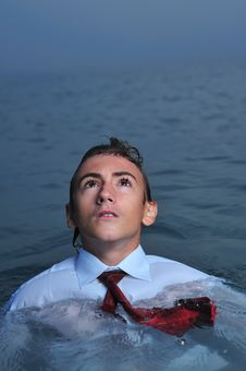 Young Businessman In Sea Stock Images
