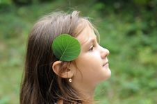 Girl And Green Leaf Royalty Free Stock Image