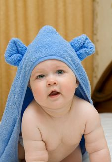 Smiling Baby In Blue Towel On Bed 12 Royalty Free Stock Image