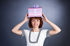 Free The Beautiful Girl With A Box Of Gifts On A Head Royalty Free Stock Photos - 6765058