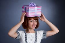 Free The Beautiful Girl With A Box Of Gifts On A Head Royalty Free Stock Photos - 6765078