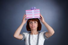 Free The Beautiful Girl With A Box Of Gifts On A Head Stock Images - 6765094