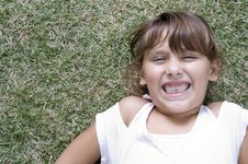 Free Laying Girl With Clenched Teeth Stock Photos - 6765473