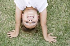 Free Girl Doing Cartwheel In The Grass Stock Images - 6765484