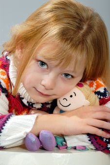 Cute Blond Girl With Her Dolls Stock Photography