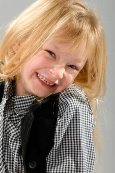 Free Cute Little Blond Girl Laughing Stock Photography - 6768522