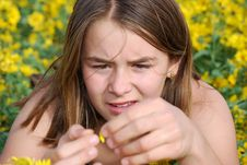 Free Girl Looking At Flower In Summer Royalty Free Stock Photos - 6768958