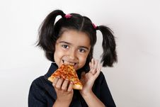 Free Girl Eating Pizza Slice Stock Images - 6769094