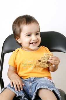 Small Girl Eating Cookies Royalty Free Stock Images
