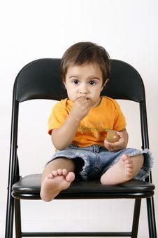 Small Girl Eating Cookies Stock Photos