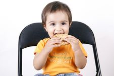 Small Girl Eating Cookies Stock Images