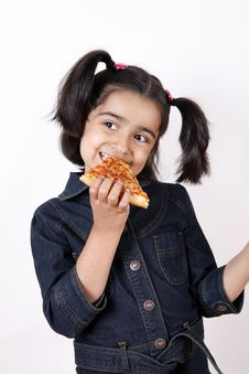 Free Girl Eating Pizza Slice Stock Photography - 6769152