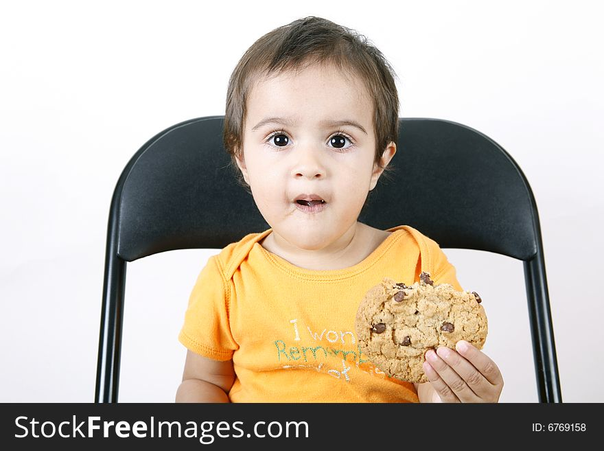 Small girl eating cookies
