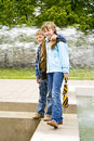 Free Boy, Girl And Fountain Royalty Free Stock Photography - 6772197