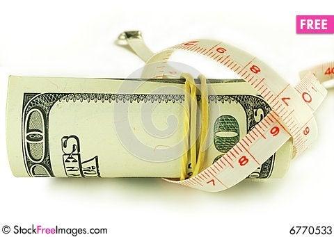 Free One Hundred Dollar Bill Roll - Dollar Grows Thin Stock Photos - 6770533