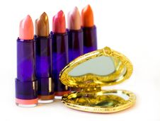 Free Five Lipsticks And Mirror Stock Image - 6770011