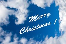 Free Merry Christmas Inscription At The Cloudy Sky Royalty Free Stock Image - 6772726