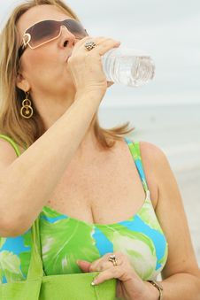 Free Woman At The Beach Drinking Water Vertical Upclose Stock Photo - 6775830