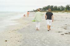 People Walkin On The Beach Royalty Free Stock Image