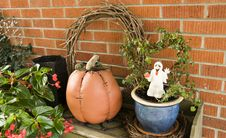 Ghost, Pumpkin And Green Plants Royalty Free Stock Image