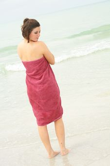 Brunette Covering Herself With A Towel Vertical Royalty Free Stock Photography