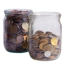 Free Two Glass Jars With Coins Royalty Free Stock Images - 6777339