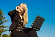 Free Woman With Laptop Talking On A Phone Stock Image - 6778011