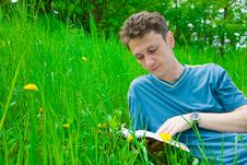Young Man Reading Stock Image