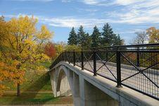 Bridge Leading Into Autumn Woods Royalty Free Stock Photo