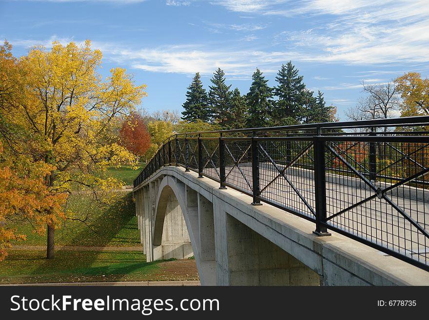 Bridge leading into autumn woods