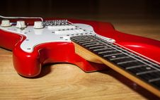 Free Body Part Of Red 6 String Guitar Royalty Free Stock Images - 67795919