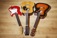 Free Three Guitars Are On The Floor Stock Photos - 67796013