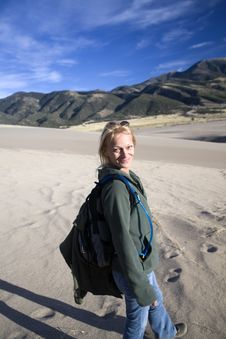 Free Smiling Hiking Woman On Sand Stock Photography - 6781132