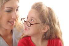 Little Girl Looking At Mom With Glasses Smiling Stock Images