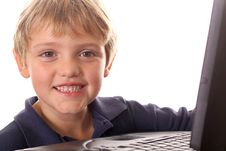 Happy Little Boy With Laptop Computer Stock Images