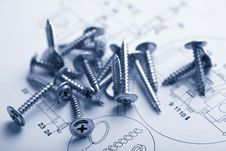 Free Metal Screws Over Technical Drawing Royalty Free Stock Image - 6789196